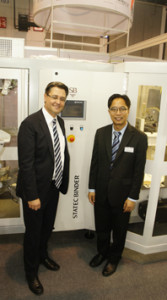 "Gerhard Steinmayr (left) and Attawit Armincen at the recent Propak Asia 2014. Statec Binder highlighted ""Principac,"" a fully automatic high-speed packing machine, net weighter SB-G and its line of high-speed palletizers."